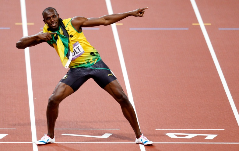 Jamaica's Usain Bolt reacts after winning the men's 200m final during the London 2012 Olympic Games at the Olympic Stadium August 9, 2012. REUTERS/Gary Hershorn (BRITAIN - Tags: OLYMPICS SPORT ATHLETICS)